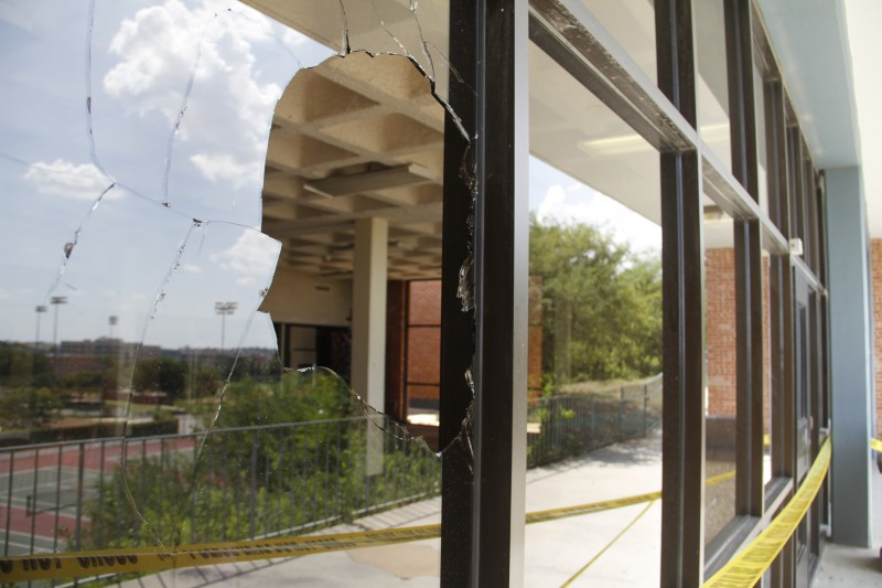 Residents of North and South residence halls could not enter the halls via the southern entrance after a pane of glass was shattered early Thursday morning. The cause of the damage remains under investigation. Photo by Aiden Kirksey.