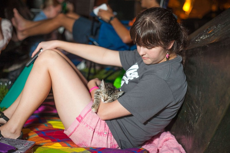 Mars McLean kitten, Twix, relaxes with senior Noelle Parsons during the Greek Life camp out next to the Magic Stones.