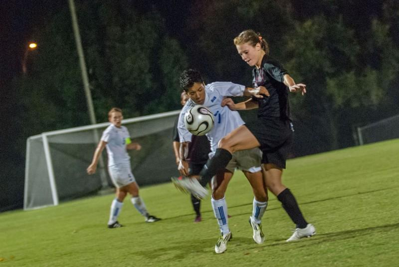 Senior midfielder Lindsay Euers controls the ball while fighting off a defender in the home game against OLLU. Photo by Anh-Viet Dinh.