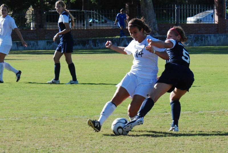 First+year+Kimberly+Polasek+steals+the+ball+away+from+the+opposing+team+during+a+soccer+game+against+the+University+of+Dallas+two+weeks+ago.+Photo+by+Sarah+Cooper.