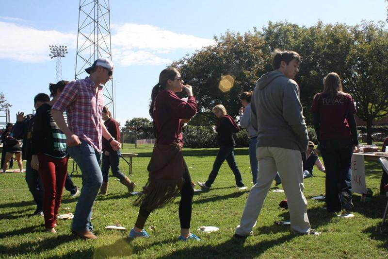 Eager to win a cake, students participate in a cake walk at the Big Six Fall Carnival before the football game on Saturday, October 27. Trinity University Volunteer Action Committee (TUVAC), Student Programing Board (SPB), Fraternity and Sorority Life, Association of Student Representatives (ASR), Student Ambassadors and Trinity Diversity Connection (TDC) form Trinity's Big Six university-sponsored organizations.