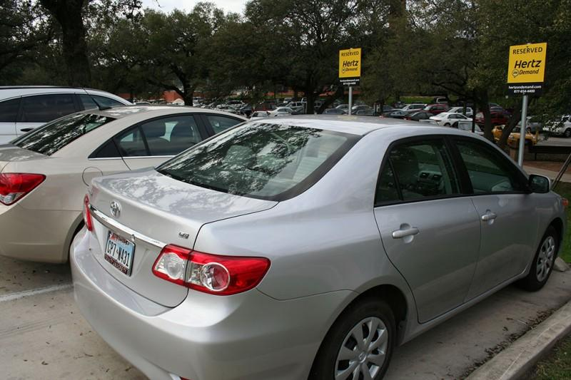 The two cars located in the parking lot across from Mabee Dining Hall may disappear if more students don't start using the Hertz On Demand program. (File photo.)