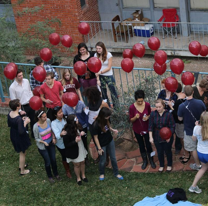 Red balloons are released tuesday in honor of Alex Reinis who passed away while abroad last year. It would have been his 22nd birthday.