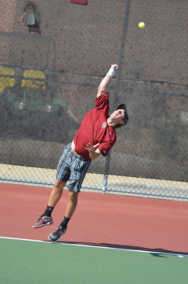 Sophomore Jordan Mayer serves a ball during his match against University of the Incarnate Word Cardinals on April 6. Photo by Anh-Viet Dinh.