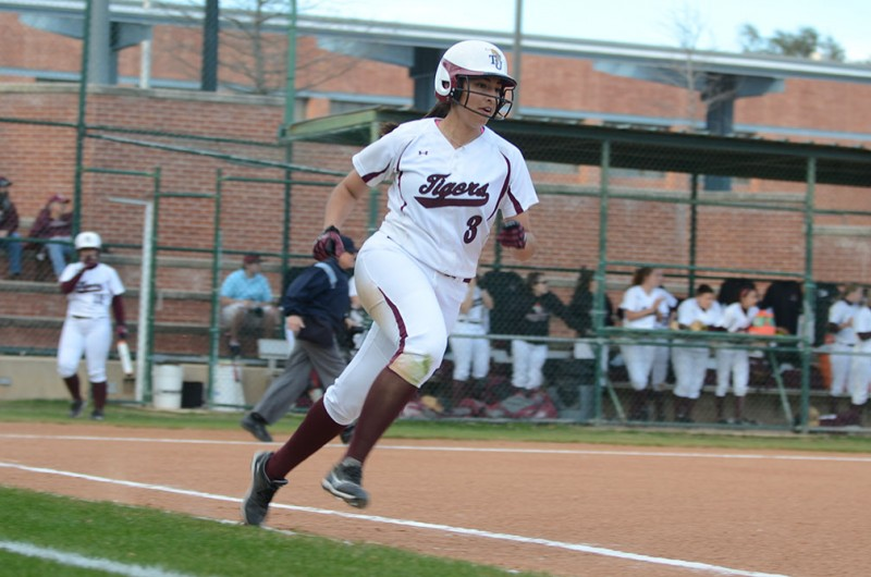 Sophomore Lauren Mercado rounds first base in a game against Schreiner University earlier in the season in which the women swept the series. Photo by Aidan Kirksey.
