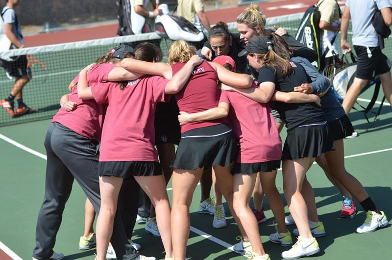 PLayers+of+the+Trinity+Tiger%27s+Womens+tennis+team+participate+in+a+traditional+group+chant+before+the+match+against+University+of+Incarnate+Word+and+Texas+Lutheran+University+last+Saturday.+Photo+by+Anh-Viet+Dinh.