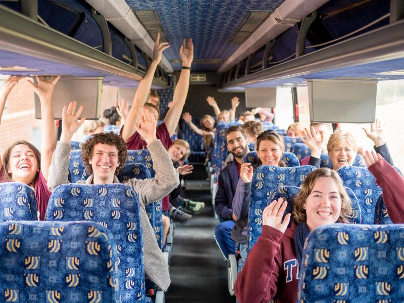 A group of volunteers made up of various students and staff members express their excitement for volunteering with TUVAC as they depart for the Trinity Gives Back event that the organization helped to organize last February.