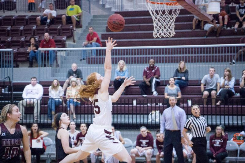 First-year forward, ABBY HOLLAND goes for a layup in a home game. Photo by OSVALDO VELOZ