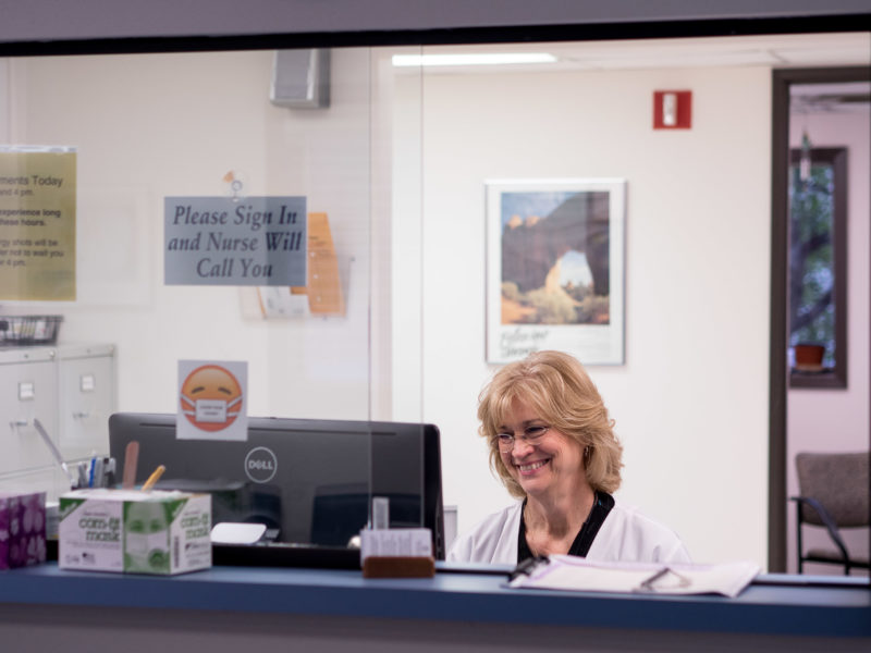 Jackie+Bevilacqua+welcomes+students+entering+Health+Services+with+a+smile.%0APhoto+by+CLAUDIA+GARCIA.