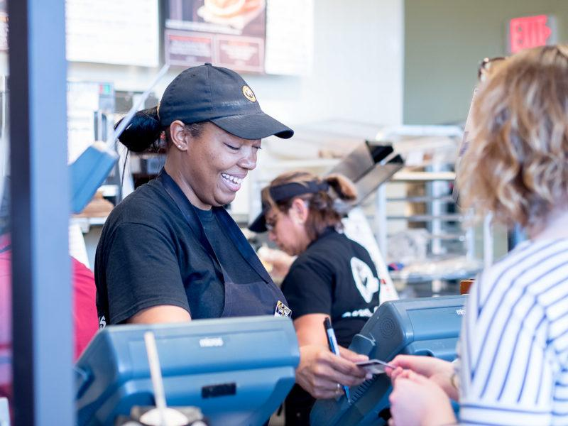 MICHELLE ALEXANDER takes a customer's order with a smile on her face during a busy afternoon at Einstein's.    Photo by Claudia Garcia