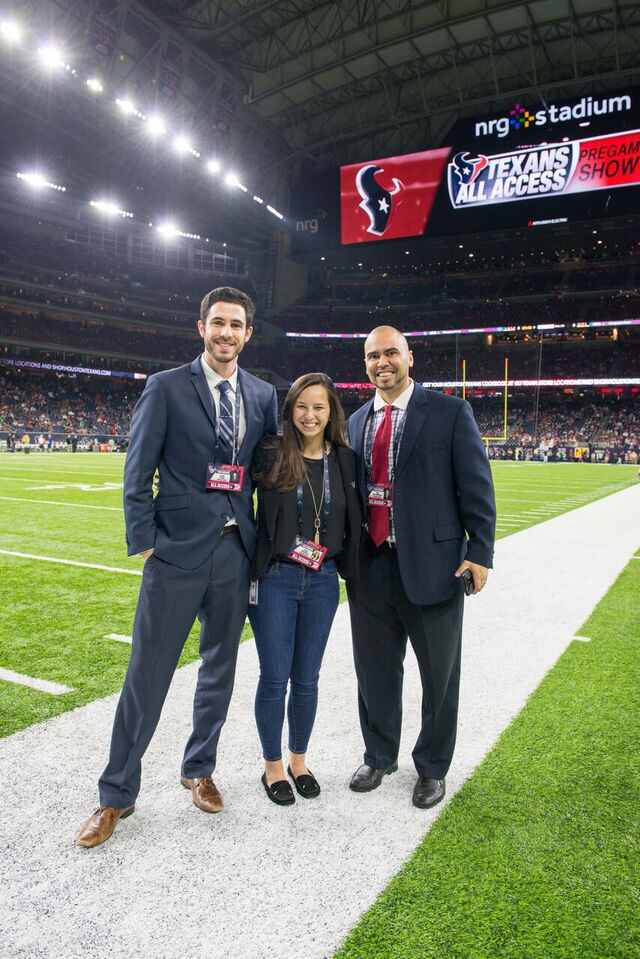 AYNAV+LEIBOWITZ+%28center%29+poses+with+her+coworker+JESSE+CLARK+%28left%29+and+boss+ERIC+SANINOCENCIO+%28right%29+on+the+field+of+NRG+Stadium+before+kickoff+begins+at+a+Houston+Texans+game.%0A%0APhoto+by+MICHELLE+WATSON