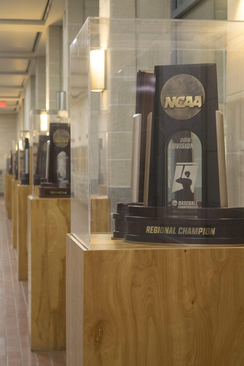 The hallway outside of the Ron and Genie Calgaard Gymnasium displays all trophies won by sports teams. Photo by Allison Wolff.