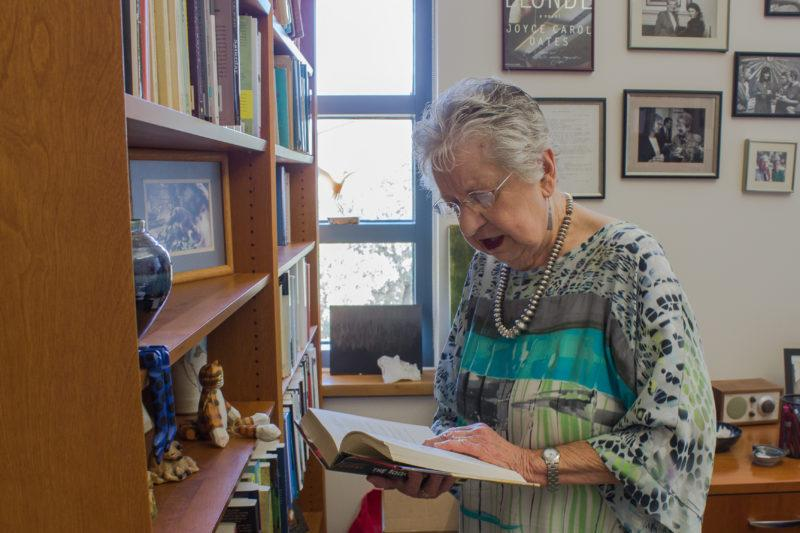 Coleen Grissom, professor of English and former dean of students, reads in her office during a quiet time before classes start up again for the fall. photo by Amani Canada