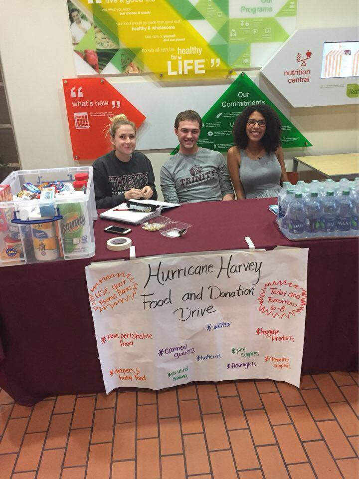 In the aftermath of Hurricane Harvey, Trinity University students, faculty and staff have banded together in efforts to support those affected by the storm, directly or indirectly, through a wide range of support groups and opportunities to donate and volunteer. Members of Greek Council joined the Student Government Association in promoting the donation drive that was held after the hurricane hit Houston. Junior Gamma Alex Gordon, left, and senior Sigma Yvette Peña, right, sit beside Travis Fulkerson, a junior SGA senator.