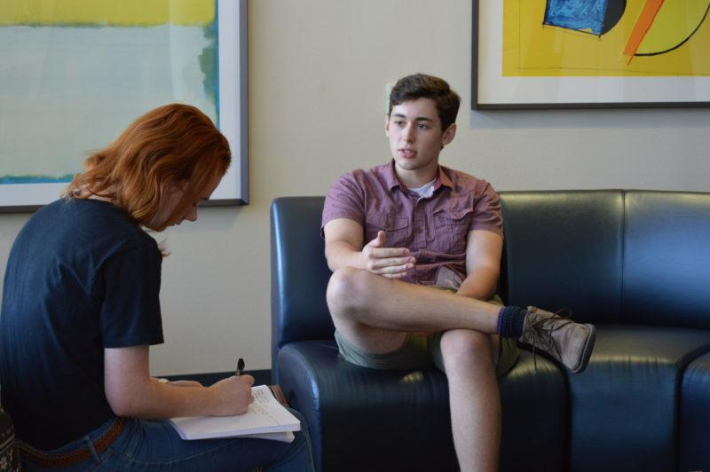 Cole Murray, a senior urban studies and political science double major, discusses the potential program with sophomore Kaylie King. Photo by Chloe Sonnier