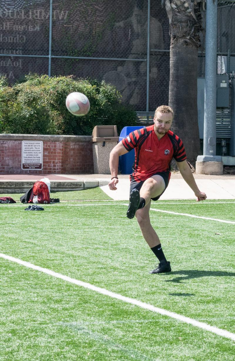Austin Gieselman, junior treasurer of the rugby team, punts the ball at one of his practices.  Photo by Allison Wolff