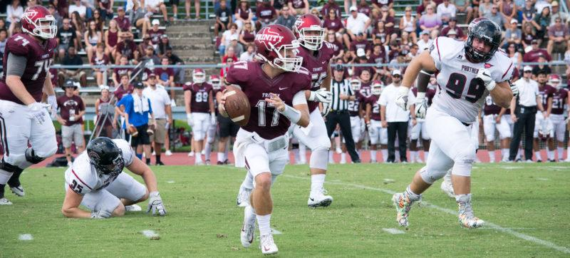 Senior quarterback AUSTIN GRAUER takes the ball across the field. The Tiger football team is excited to keep their momentum going after winning the first home game. Photo by Allison Wolff