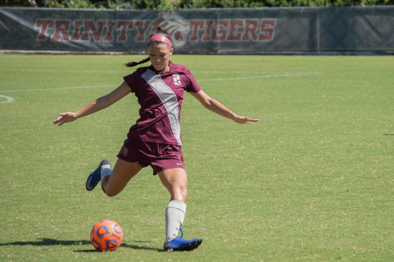 First-year defender Lindsey Peng shoots the ball across the field. photo by Allison Wolff
