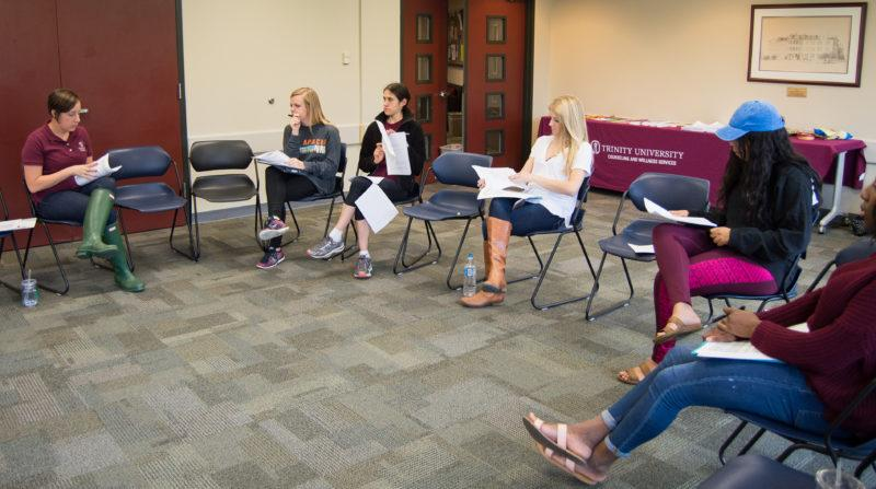 Students listen to Katherine Hewitt, coordinator of Wellness Services, in a public Body Project training session hosted Friday, Sept. 29. photo by Chloe Sonnier