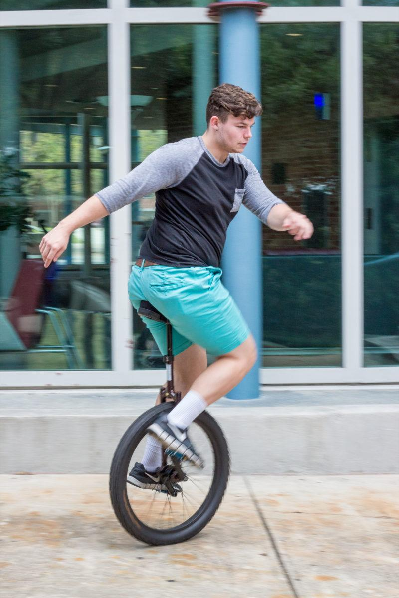Aiden Burke unicycles to class every day.