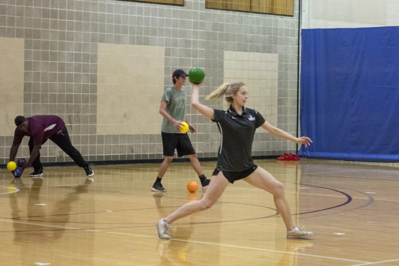 Senior Madeline McKay gets into the zone in this intramural dodgeball game. Photo by Allison Wolff