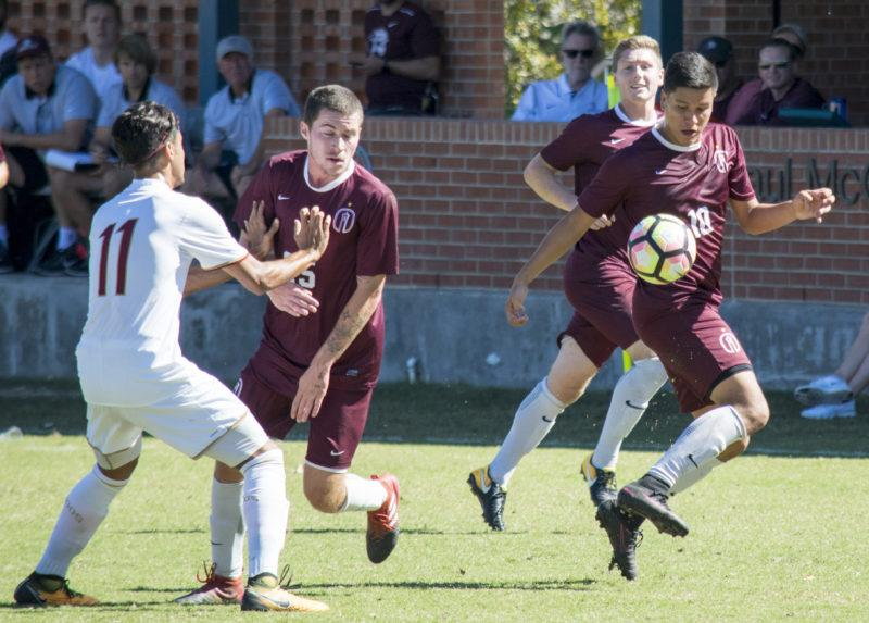 Christian Sakshaug, left, Quentin Van Der Lee, back right, and Daniel Ruano, front right, fought valiantly for men's soccer this season. Photo by Allison Wolff, staff photographer