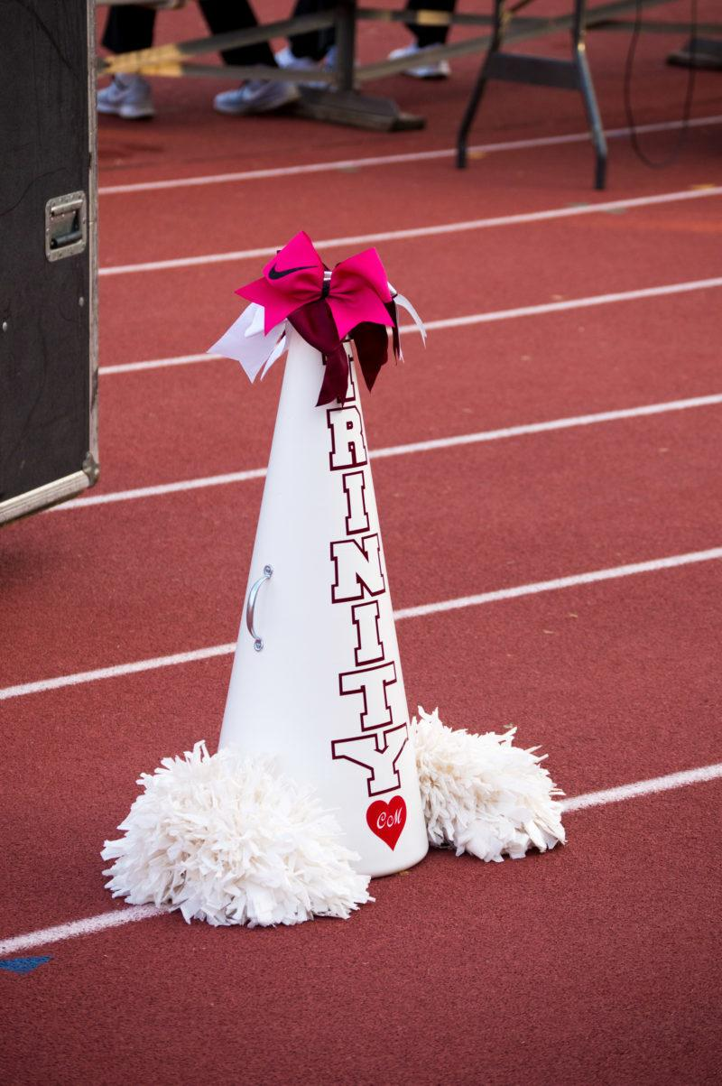 Cayley Mandadi's spot in the cheer line was saved for her with a bow and initialed horn at the final home game.  photo by CHLOE SONNIER