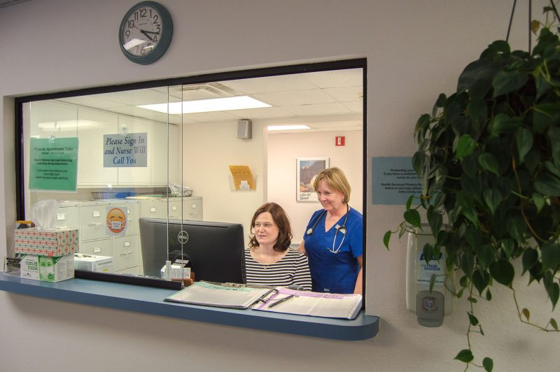 Office manager Judy Norris, left, and registered nurse Beth Barnes, right, both work in the Health Services office. After Barnes' retirement, the office will no longer have Sunday hours available. Photo by Chloe Sonnier, staff photographer.