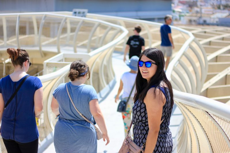 Brenda Ramos smiles as she crosses the Metropol Parasol bridge in Sevilla, Spain during Trinity's first semester-long study abroad program in Spain last fall. photo provided by Katsuo Nishikawa