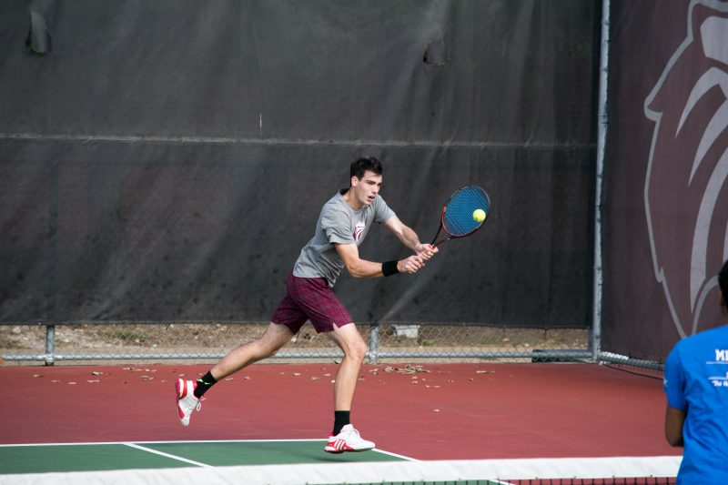 Junior Wilson Lambeth competes in a match vs. Texas A&M - Corpus Cristi on Jan. 28. photo by Allison Wolff, staff photographer