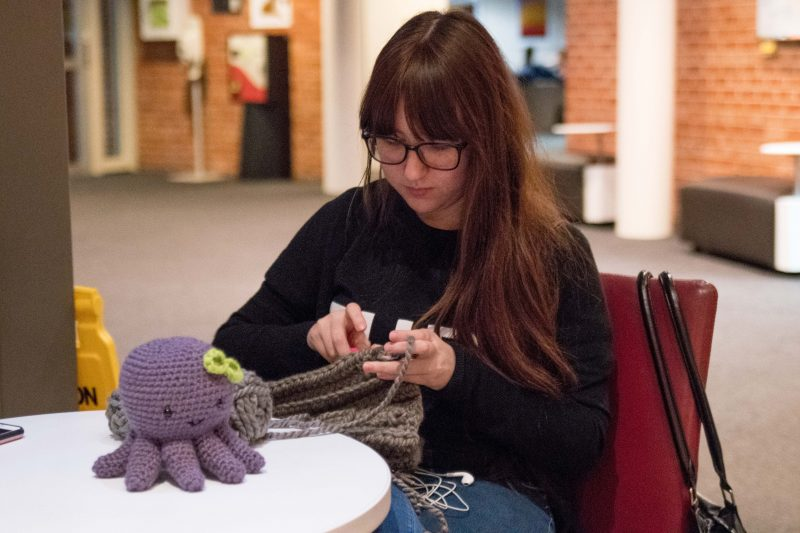 Sophomore+Alexandra+Parris+crochets+in+the+CSI+building.+After+taking+up+crocheting+in+2016%2C+Parris+began+offering+her+skills+to+other+students+at+a+small+price.+photo+by+Stephen+Sumrall-Orsak