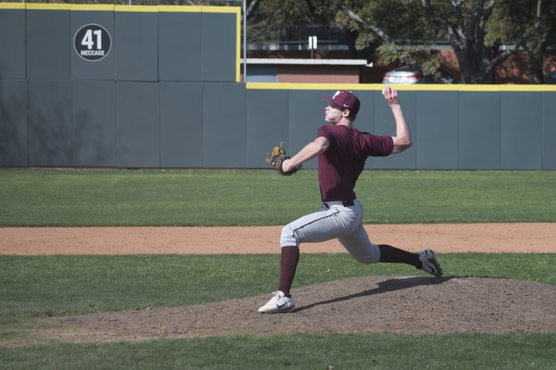 Jake West, junior, pitches during practice. photo by Allison Wolff, staff photographer