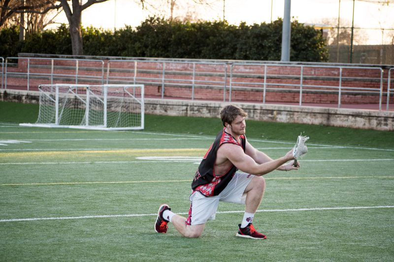 Senior captain Ben Mulford warms up for practice on Feb. 14. photo by Allison Wolff, staff photographer