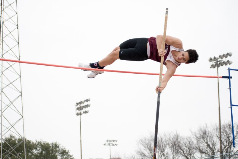 Stephen Ford, freshman, competes in pole vault. photo by Allison Wolff, staff photographer