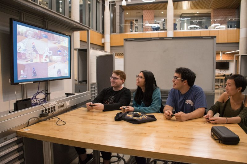 From left: Sophomores William Ballengee, Tiffany Nguyen, Benjamin Gonzalez and Rachel Lopez play Mario Kart 8 Deluxe in the CSI Cube. Photo by Chloe Sonnier, staff photographer.