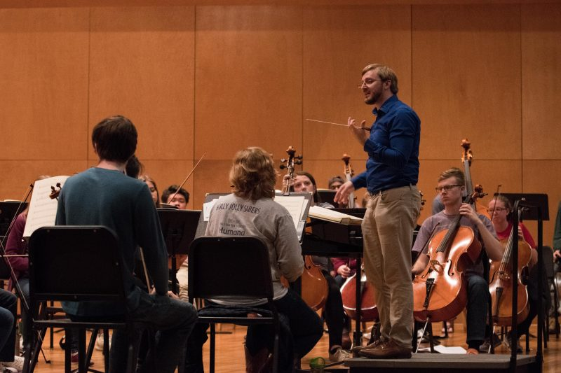 Joseph Kneer, right, leads the Trinity Symphony Orchestra in rehearsal. photo by Chloe Sonnier, staff photographer
