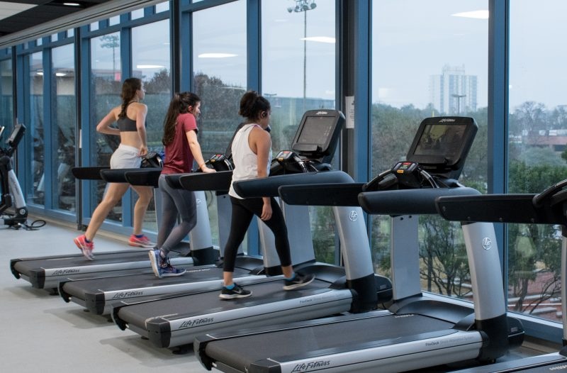 Sophie Wikstrom, Emily Cruz and Daniela Molina, left to right, work out on the cardio deck. photo by Chloe Sonnier, staff photographer