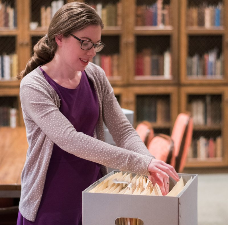 Colleen Hoelscher looks through files in the Rare Books room. photo by Stephen Sumrall-Orsak, staff photographer