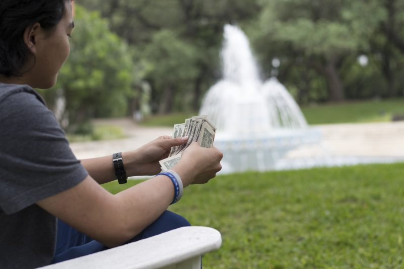Strategic Communications and Marketing pays students for 'studying' by fountain