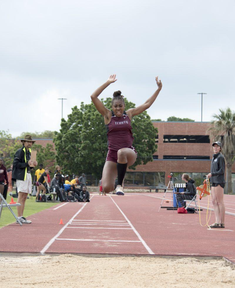 Senior Brittney Sullivan participates in the long jump. photo by Allison Wolff, staff photographer