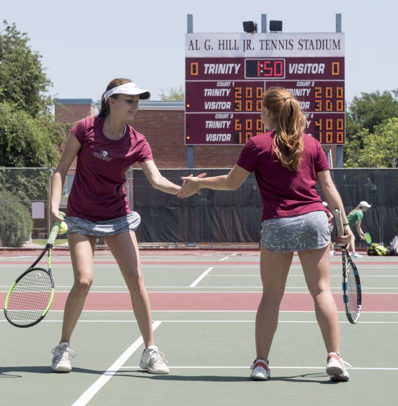 Sophomore+Francesca+Canjar+and+first-year+Paulina+Garcia+high+five+during+the+match+vs.+UT-Dallas+last+Sunday.+photo+by+Allison+Wolff%2C+staff+photographer