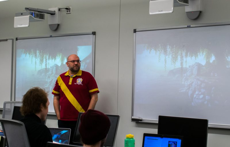 Matthew Hibbs teaches his computer science class about video games. photo by Allison Wolff, staff photographer