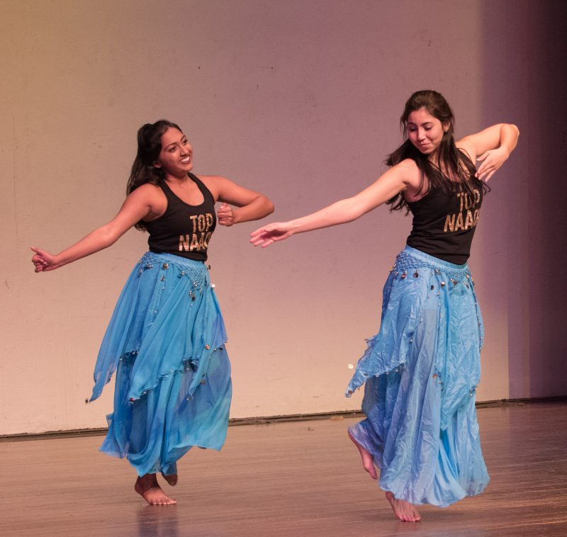 Sophomore Natasha Muppala, left, and junior Victoria Abad, right, preformed as a part of Top Naach, Trinity's Bollywood dance team, at Henna Night. Trinity's Muslim Student Association organized the event. photo by Chloe Sonnier, staff photographer