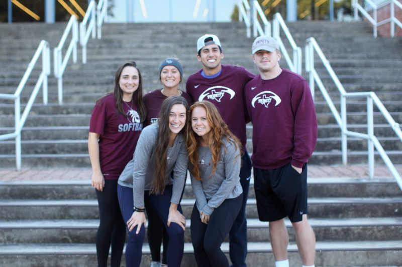 Gina Monaco, Allie Holbrook, Connor Macias, Michael Jewett, Annie Wise, and Paulina Garcia pose with their roommates. Photo credit: Megan Flores