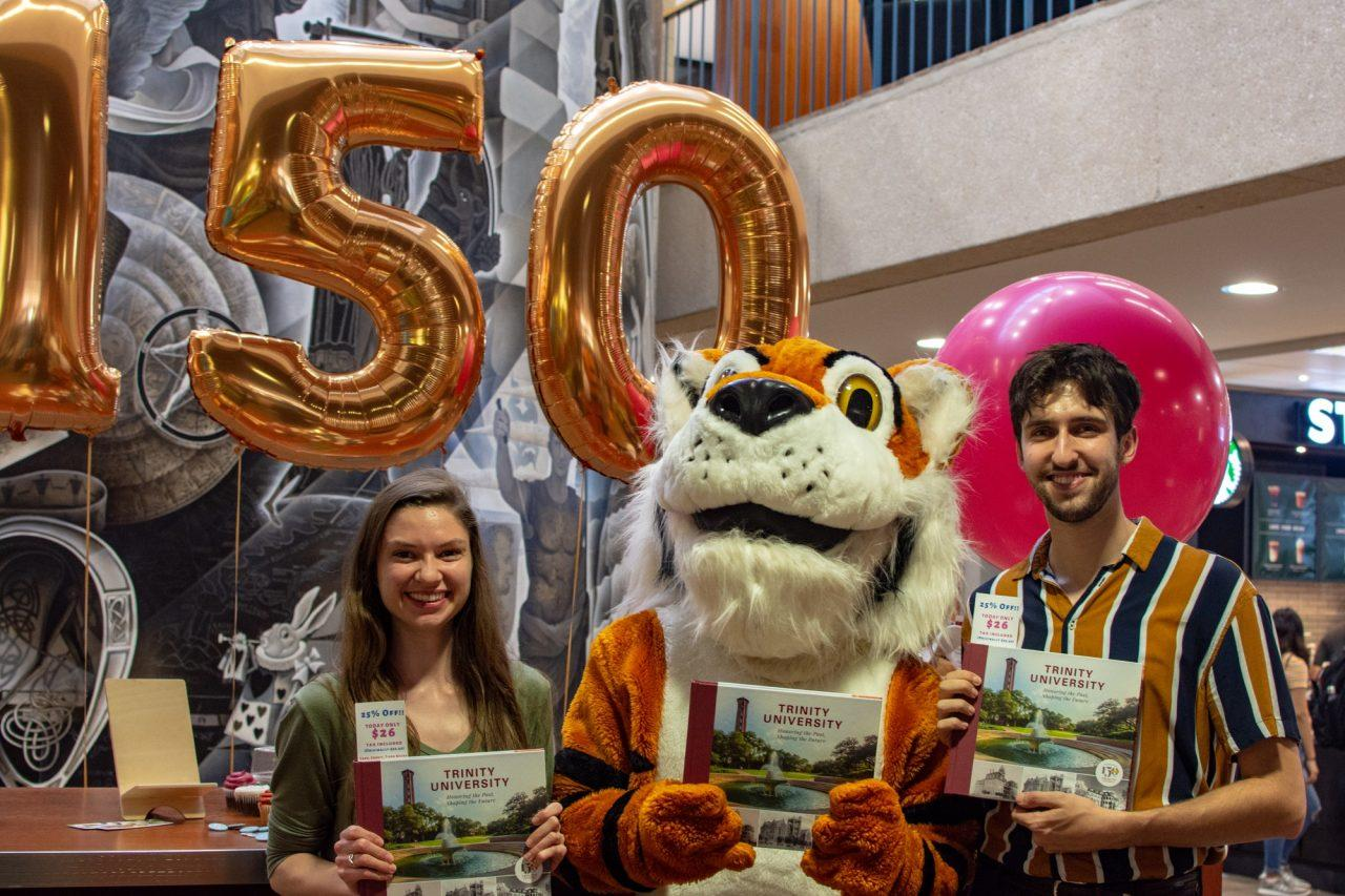 Students gather with Leeroy to celebrate the launch of the #TU150 book in Coates Library Photo credit: Genevieve Humphreys