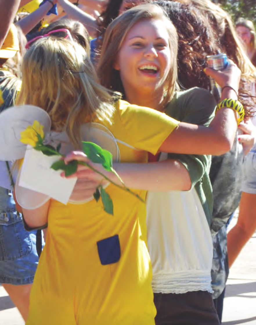 Then-sophomore Amanda Beekes (left) hugs then-first-year and new Spur member Jacki Bruce (right) on Bid Day in 2010 Photo credit: File Photo