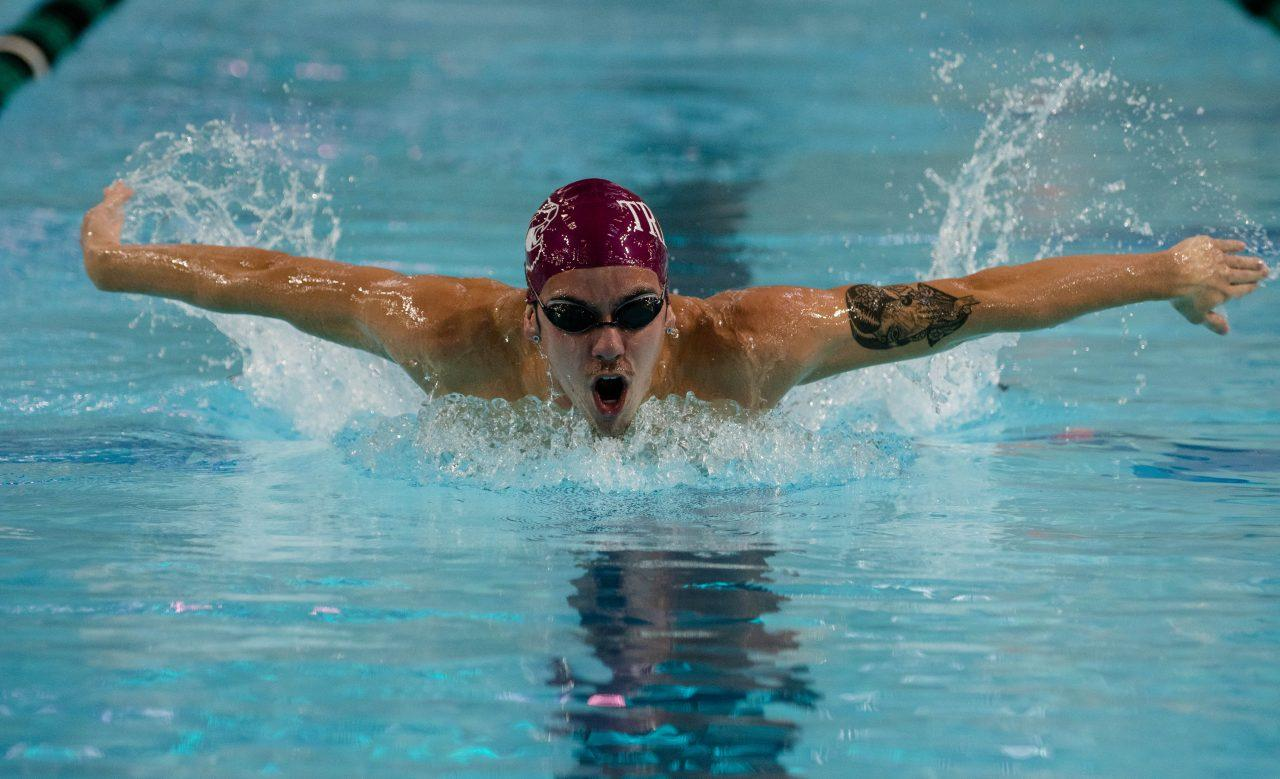 Sophomore Connor McClure swimming butterfly