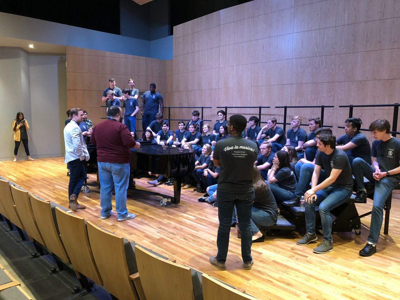Chamber Singers debrief before performing for HSPVA choral students.