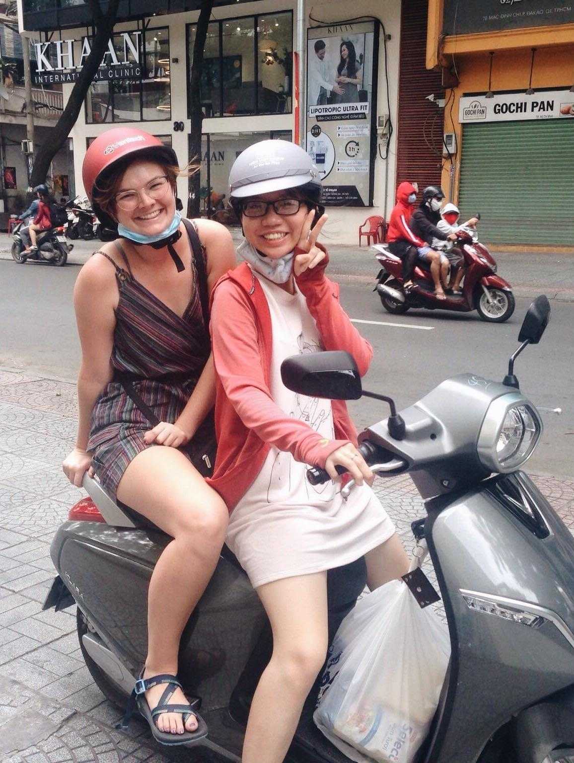 Carson Bolding, left, and her roommate Ngân Trần, riding through District 1 of Ho Chi Minh City. They had just returned from grocery shopping for ingredients to make spring rolls for Vietnamese Independence Day. Photo credit: Carson Bolding