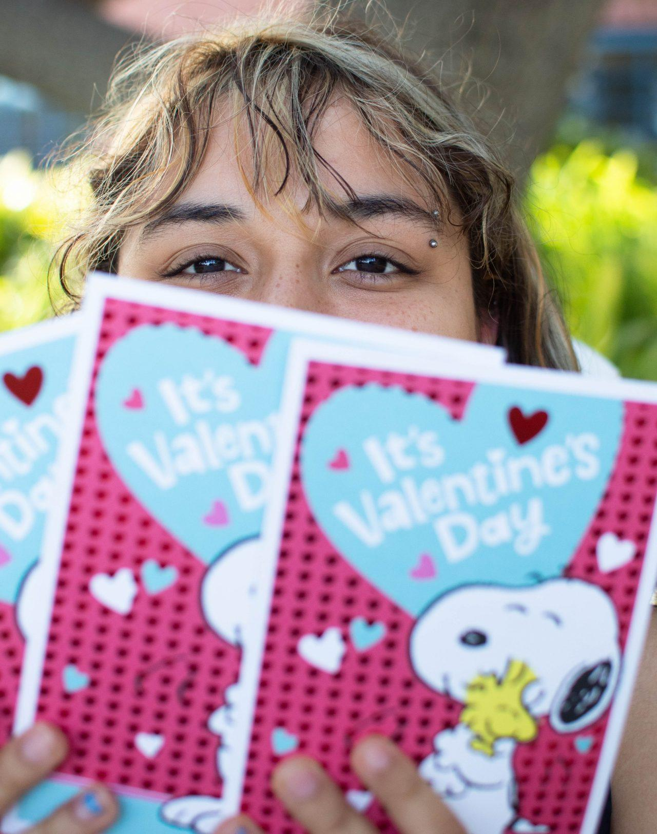 Kayla Padilla is holding a handful of valentine cards Photo credit: Elizabeth Nelson